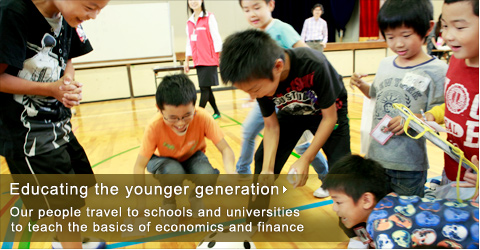 Educating the younger generation Our people travel to schools and universities to teach the basics of economics and finance